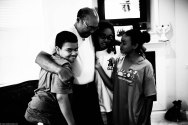 Dad hugging his grandkids after getting his Father's Day card.