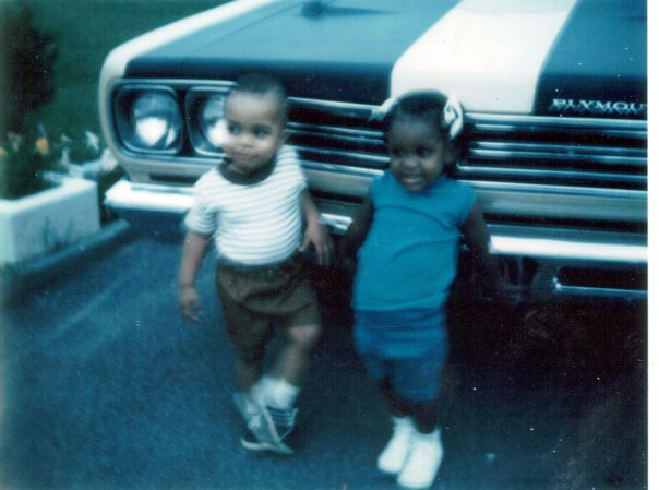 Cousin Johnsie and I in front of my Dad's Road Runner.